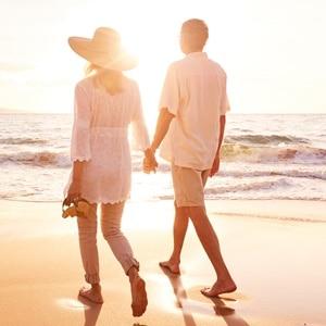 Happy Romantic Middle Aged Couple Enjoying Beautiful Sunset Walk